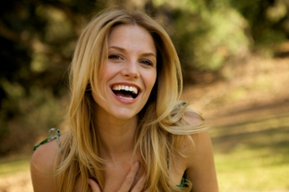 Beautiful blonde girl with toothy smile